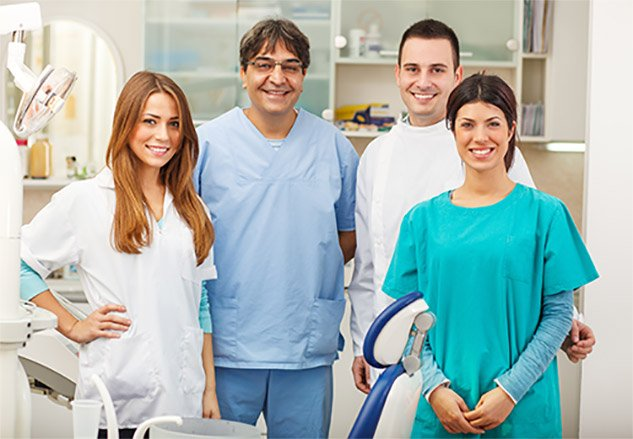 A team of dentists and assistants